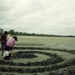 Kids designing the spiralling sculpture in the sand, Bouchat Holiday Program