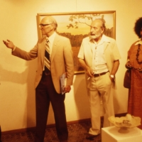 At the opening of their joint exhibition in Cairns, Thancoupie, Percy Trezise, and Dick Roughsey - pioneer artists of North Queensland. 1975, Photo by Jennifer Isaacs
